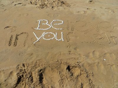 """be you"" written in the sand"