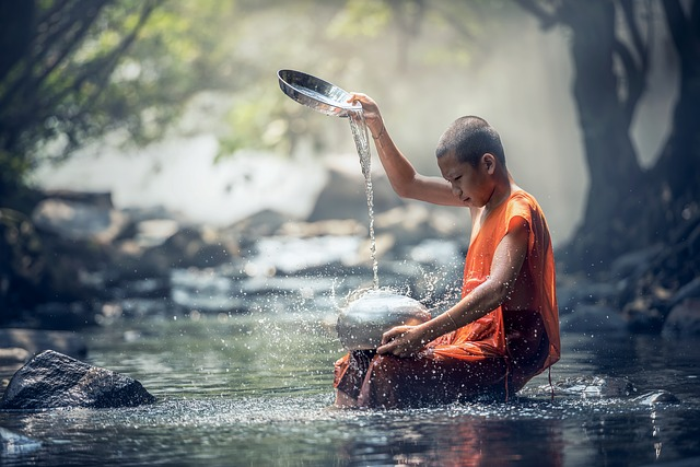 child meditating and pouring water down