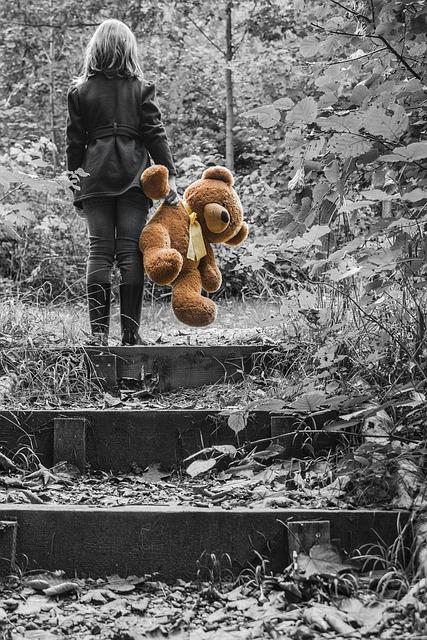 girl holding a stuffed bear