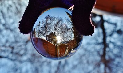 glass ball being held in the winter time