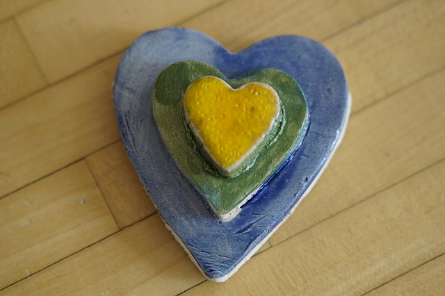 wooden heart painted blue and yellow