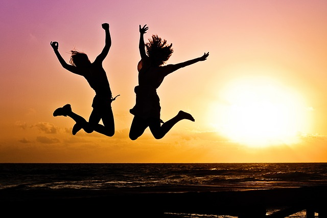 2 people jumping for joy