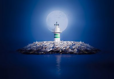 lighthouse in the center of a pile of rocks