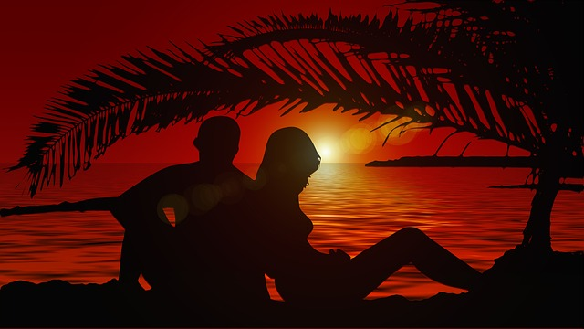 two people on a beach together