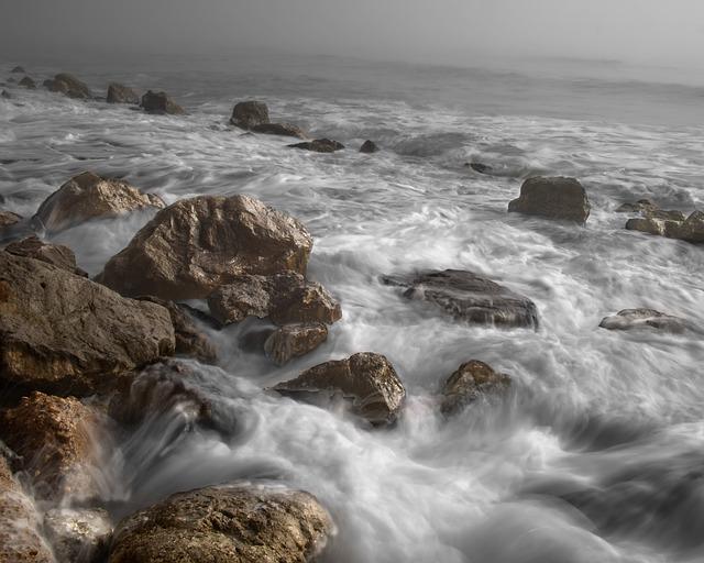rocky ocean tide coming in