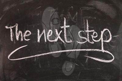 The next step written on a blackboard